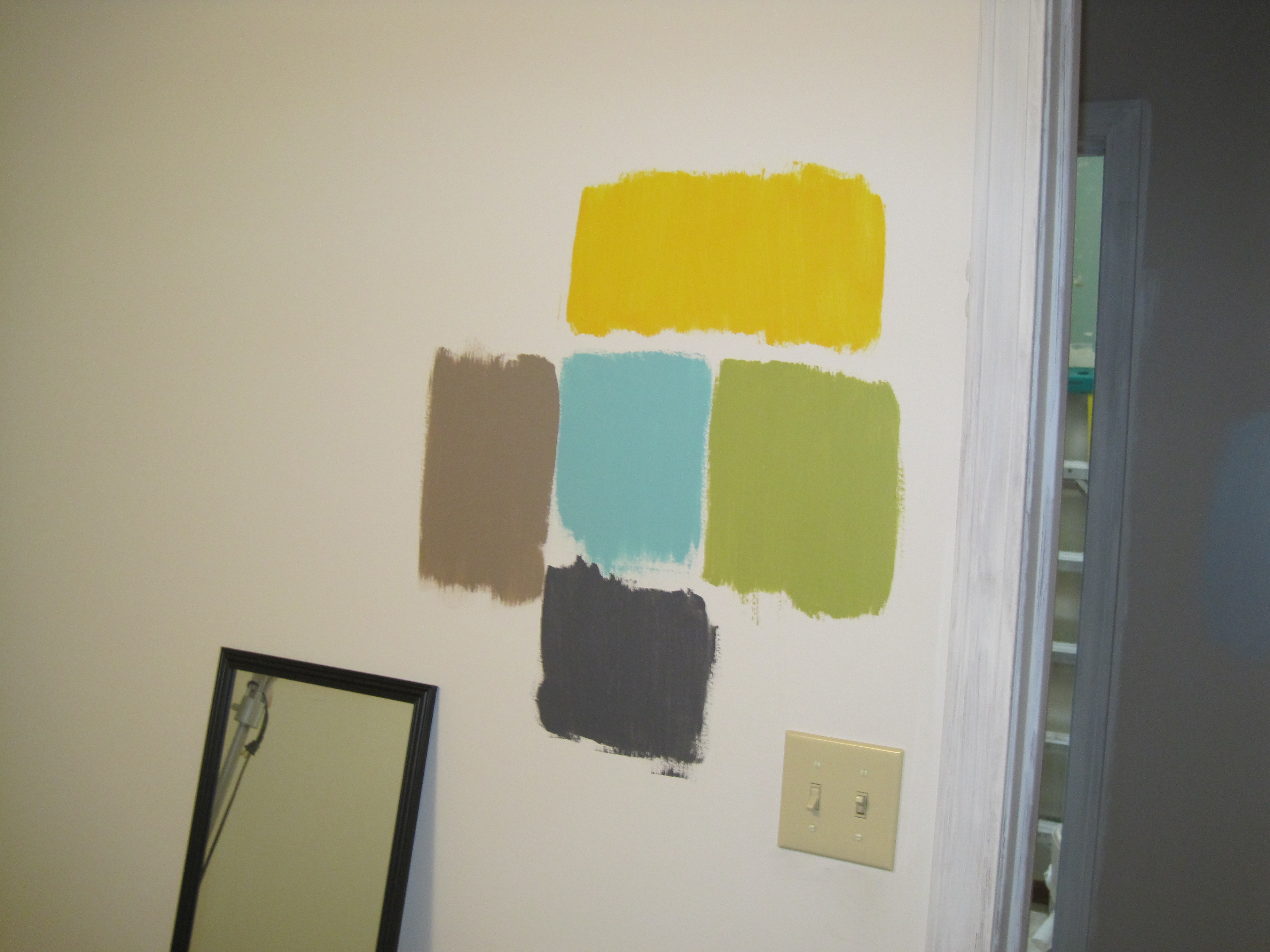 This is what the wall in my office looked like until yesterday. After pictures coming soon. Any guesses on which color I chose?