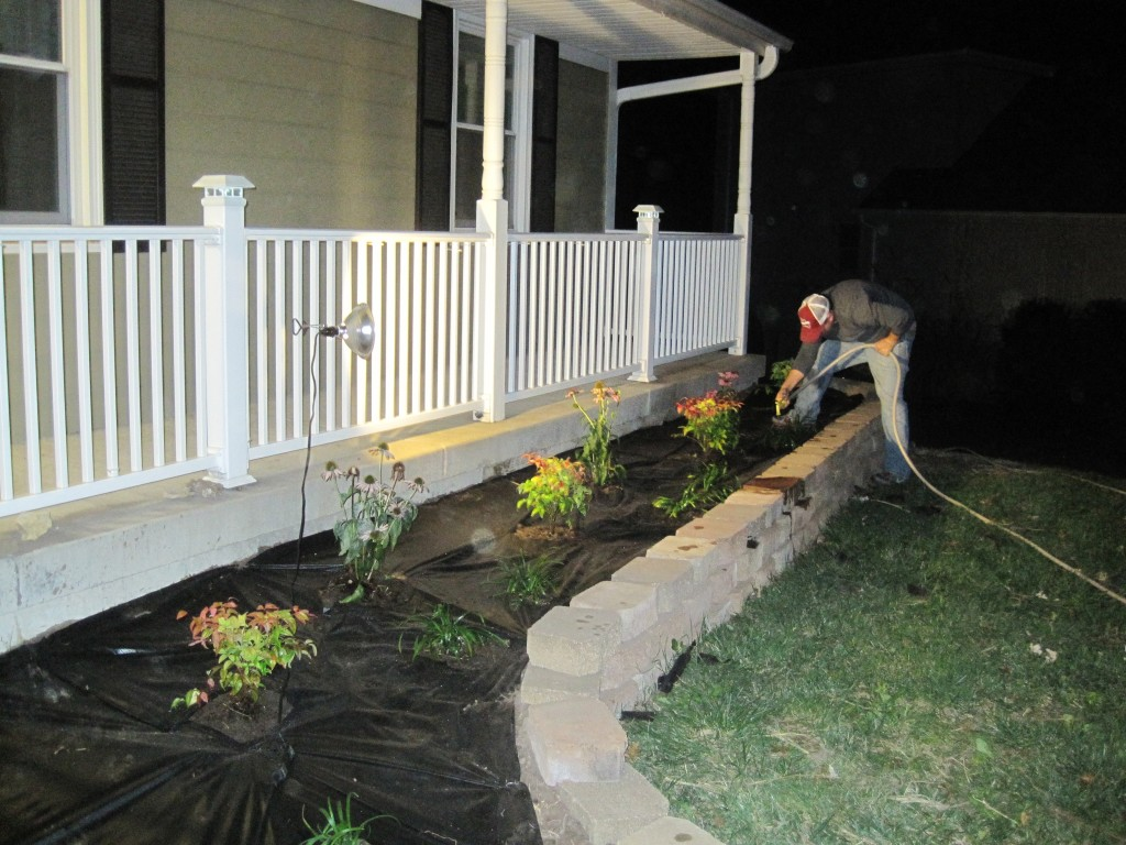 Watering Front Landscaping at Night