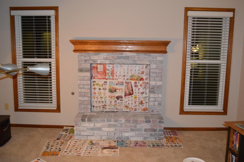 Basement fireplace whitewashed