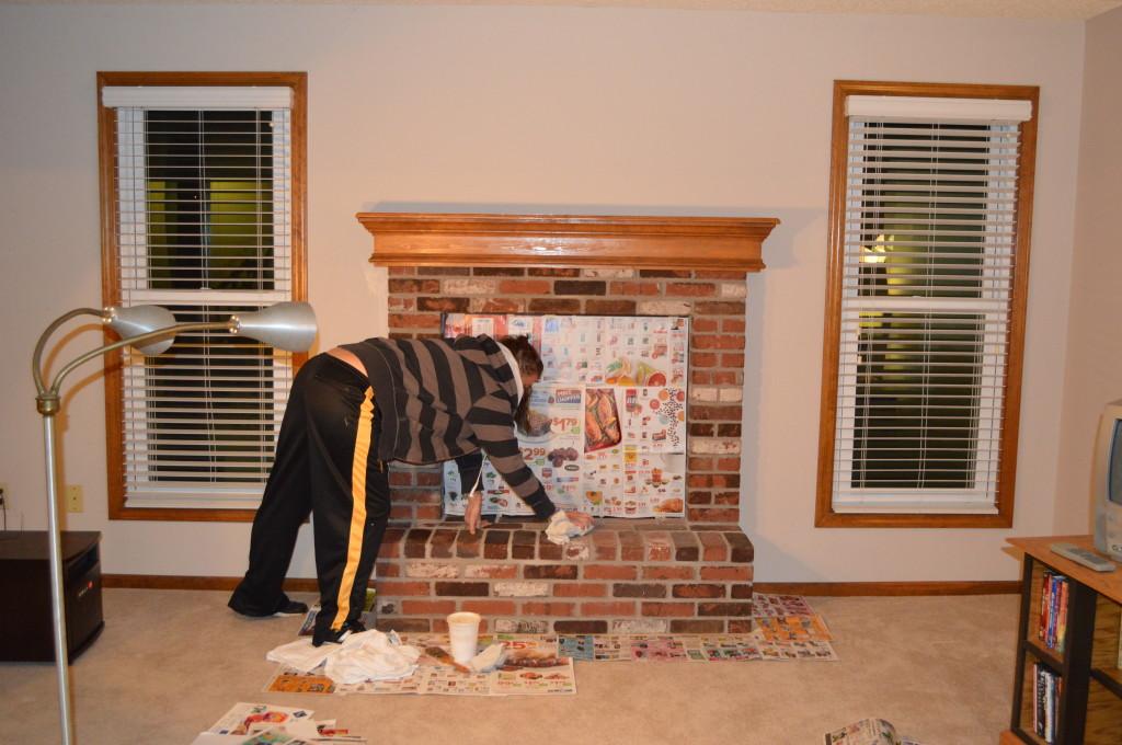 Whitewashing basement fireplace