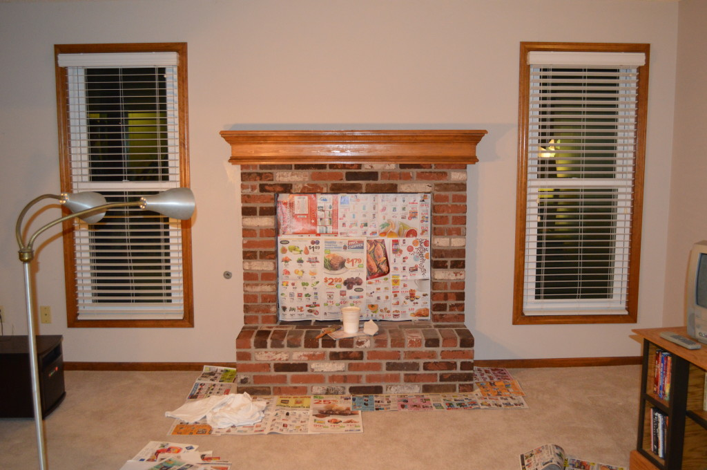 Whitewashing basement fireplace before