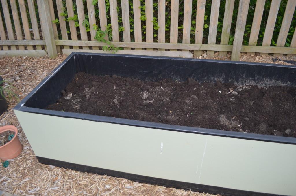 Adding dirt to garden beds 2014