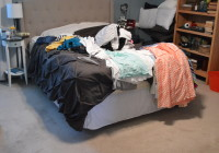 Laundry Pile On Bed