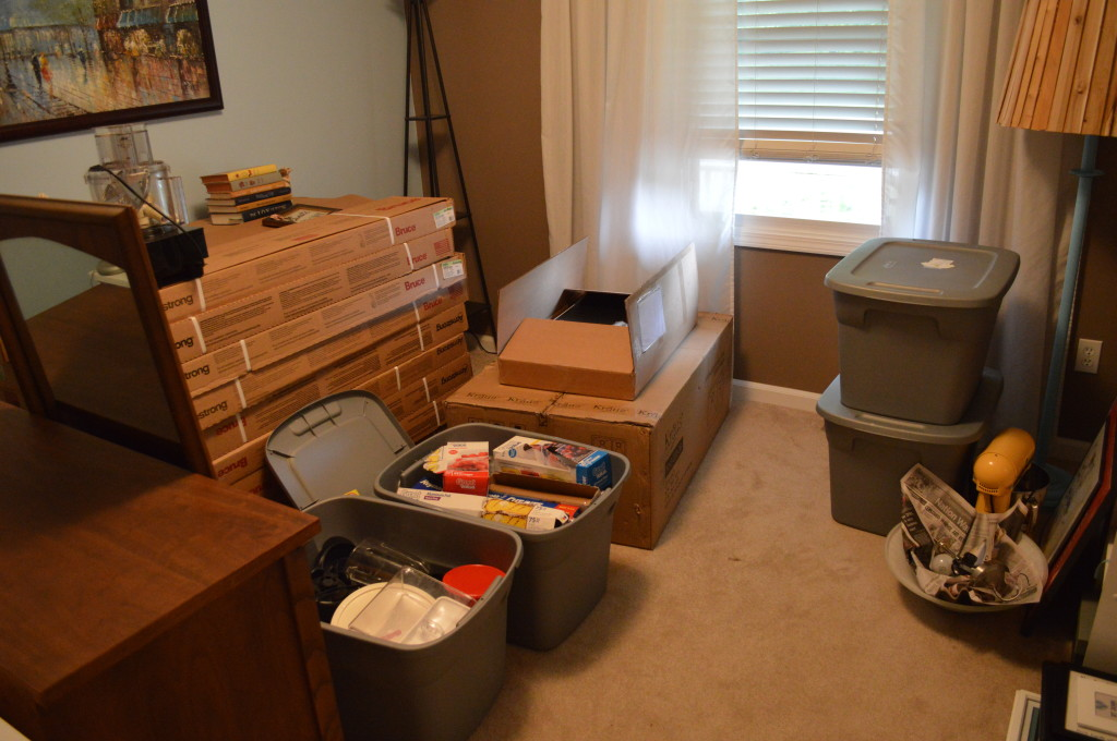Messy guest room with kitchen stuff and flooring
