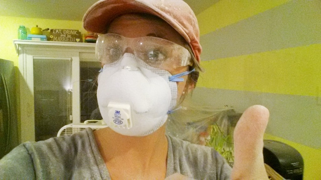 Drywall Sanding With Face Mask