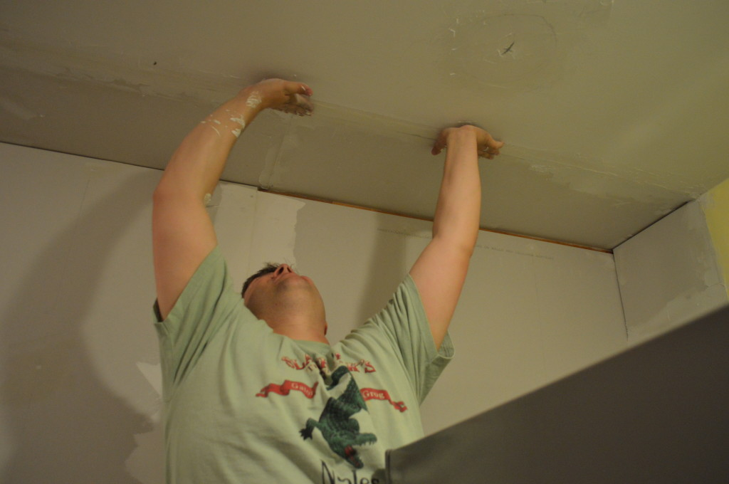 Putting Drywall Tape on Ceiling