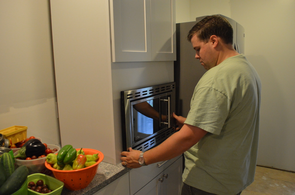 Dry-fitting Microwave Into Kitchen Cabinet