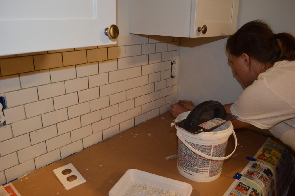 Applying small Corner tiles to kitchen backsplash