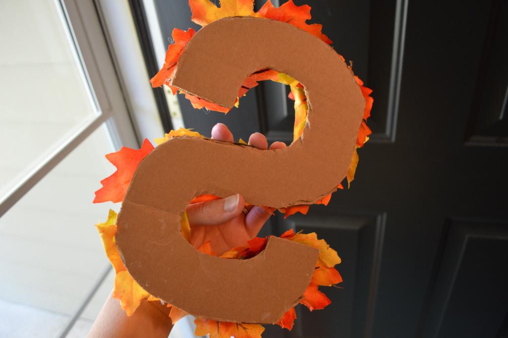DIY leaf covered cardboard initial for fall wreath
