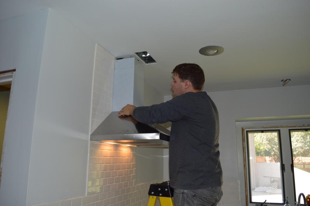 Installing Range Hood Vent Cover in Kitchen