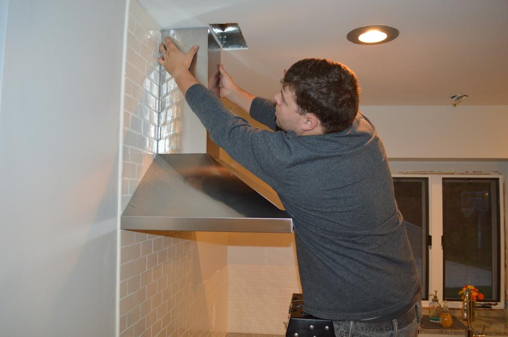 Installing Range Hood Vent Cover in Kitchen 3