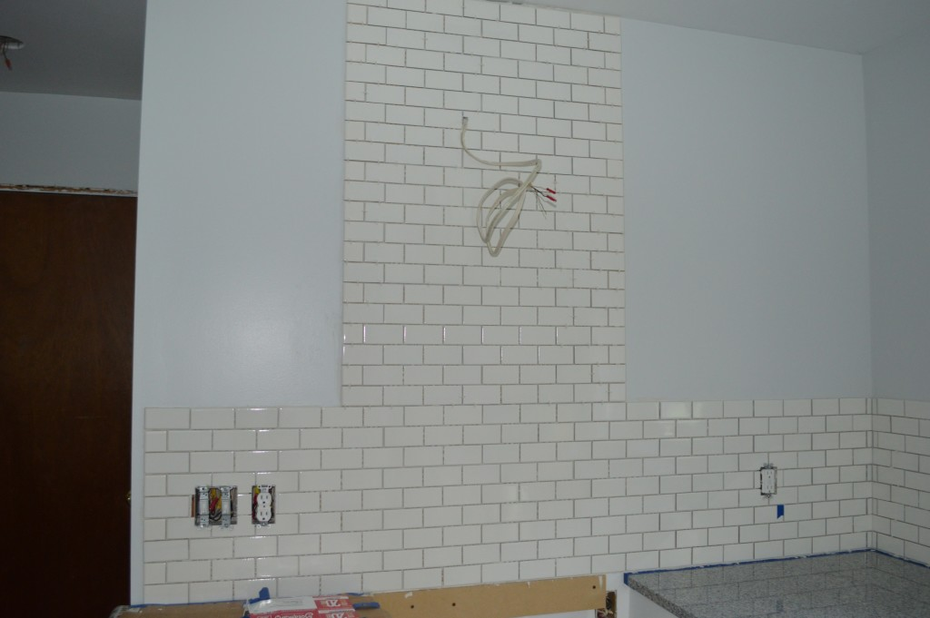 Tile backsplash behind range