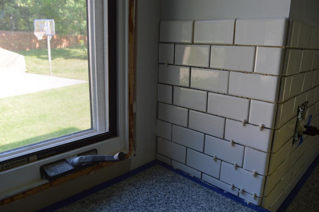 Tiled backsplash done before grout window