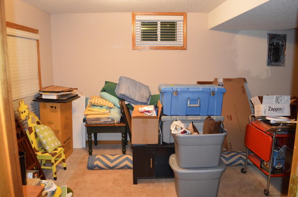 Messy Basement Guest Room Full of Stuff