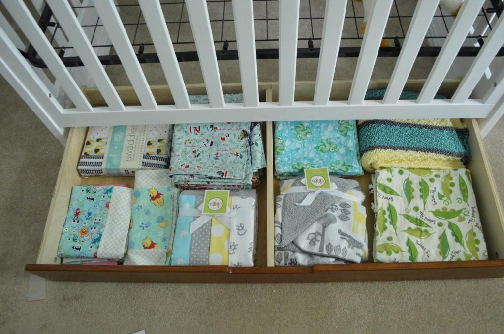 Assembled Crib Drawer Full of Blankets