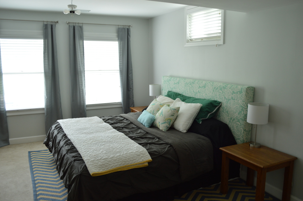 Guestroom bed with curtains and nightstands