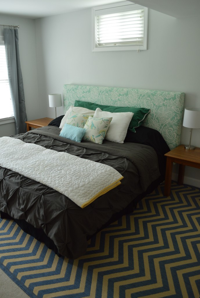 Guestroom bed with curtains and nightstands 2