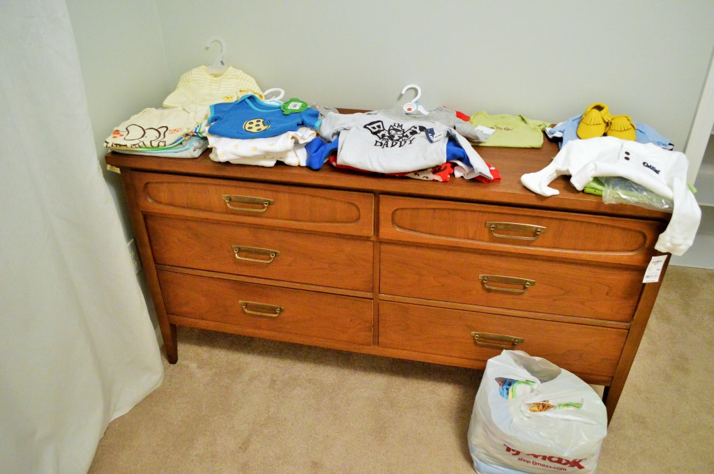 Sorting Beanie's First Clothes on Nursery Dresser