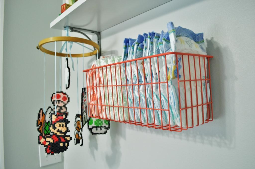 Nursery Diaper storage in wall basket