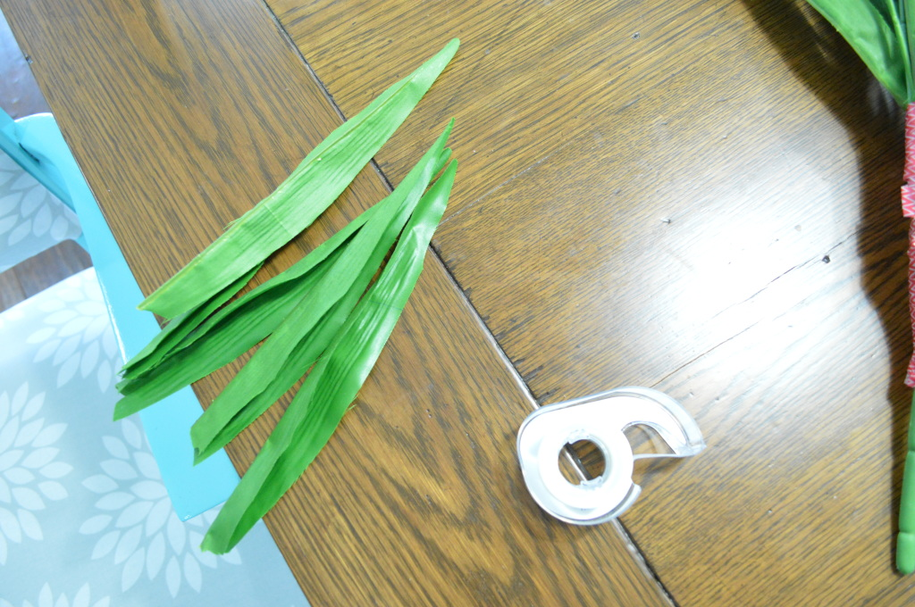 DIY Newsprint Wrapped Tulip Wreath for Front Door adding leaves