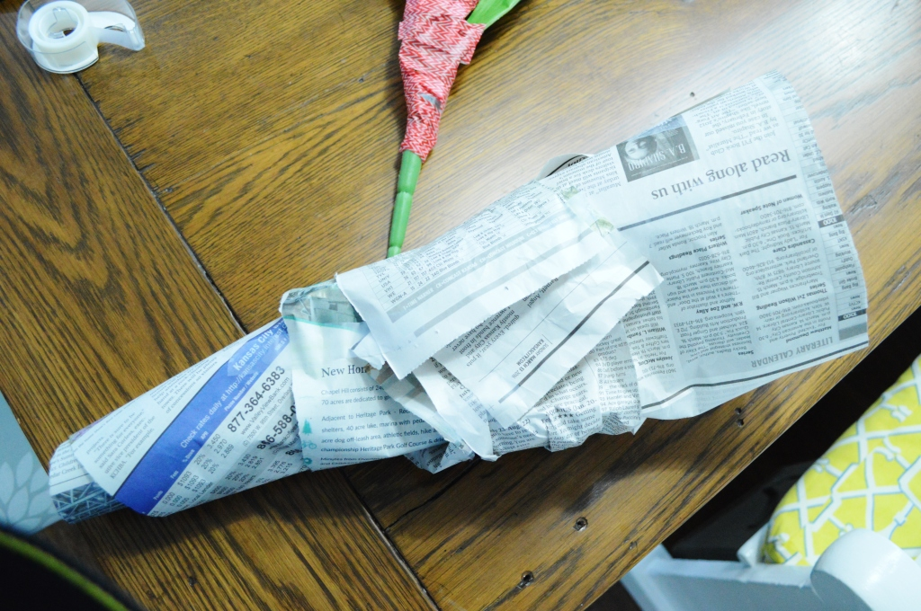 DIY Newsprint Wrapped Tulip Wreath for Front Door adding leaves newspaper