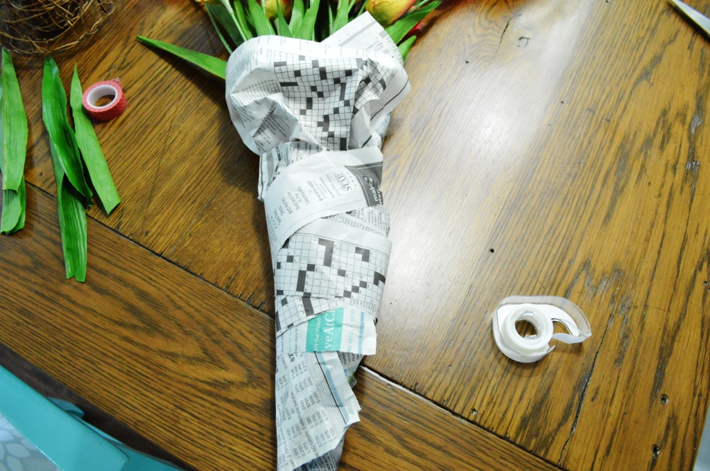 DIY Newsprint Wrapped Tulip Wreath for Front Door adding leaves newspaper 2