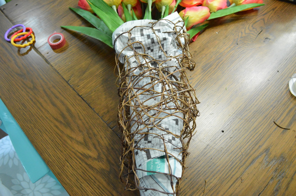 DIY Newsprint Wrapped Tulip Wreath for Front Door grape vine garland