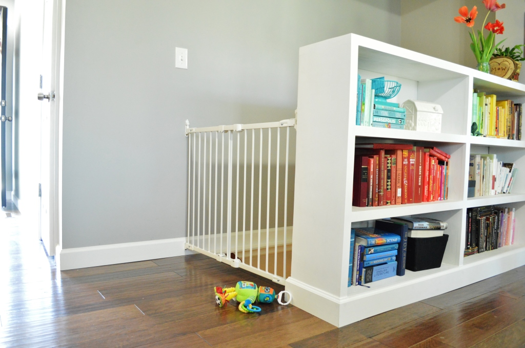 Baby gate installed on top of stairs