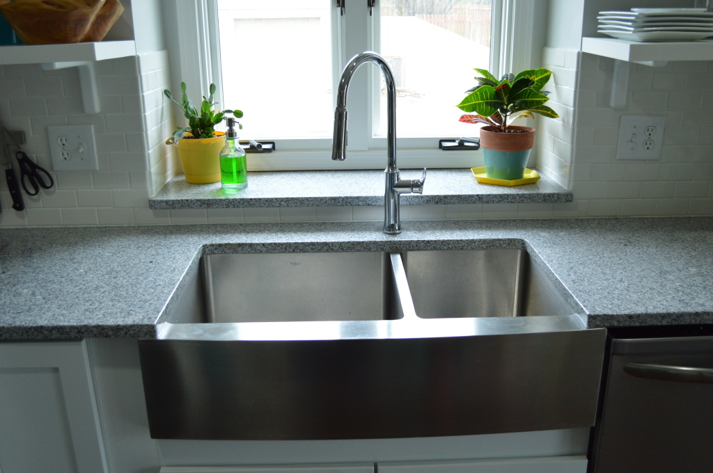 New garbage disposal in farmhouse sink
