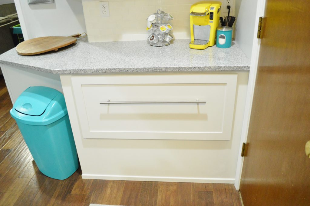Finished White Kitchen Renovation with DIY custom cabinetry and appliance drawer nook