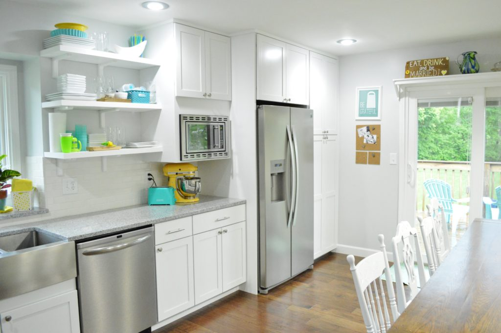 Finished White Kitchen Renovation with custom DIY pantry and built in fridge and microwave