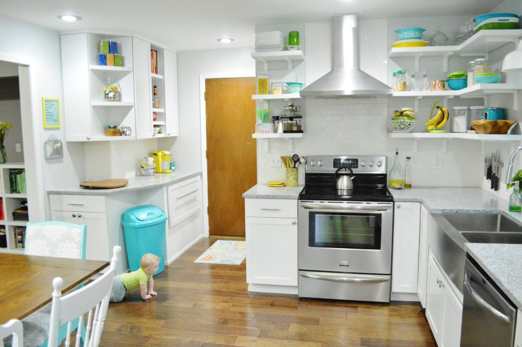 Finished White Kitchen Renovation with stainless steal range hood-blue trashcan-custom open shelves 2