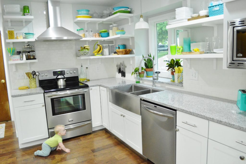 Finished White Kitchen Renovation with stainless steal range hood-custom open shelves