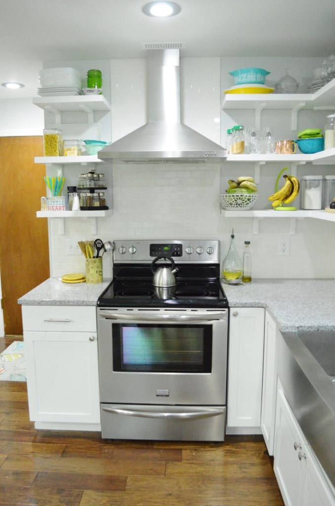 Finished White Kitchen Renovation with stainless steal range hood-custom open shelves 3