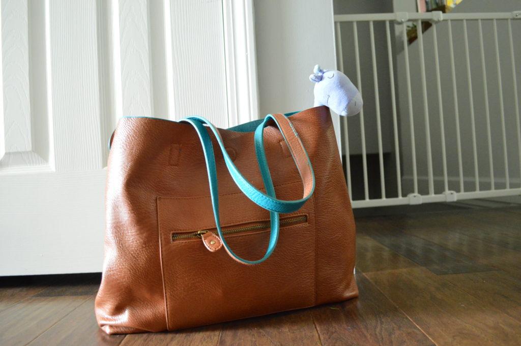 Modern diaper bag that looks like a purse