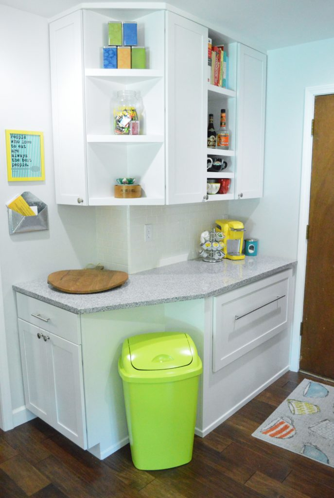 Neon green spray painted kitchen nook trash can