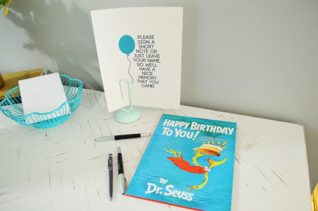 Simple blue and gold first birthday party decoration Dr. Seuss guest book