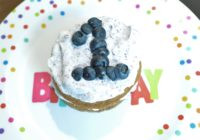 Simple blue and gold first birthday party healthy blueberry cake