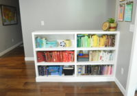 Toy storage in living room built in bookshelves