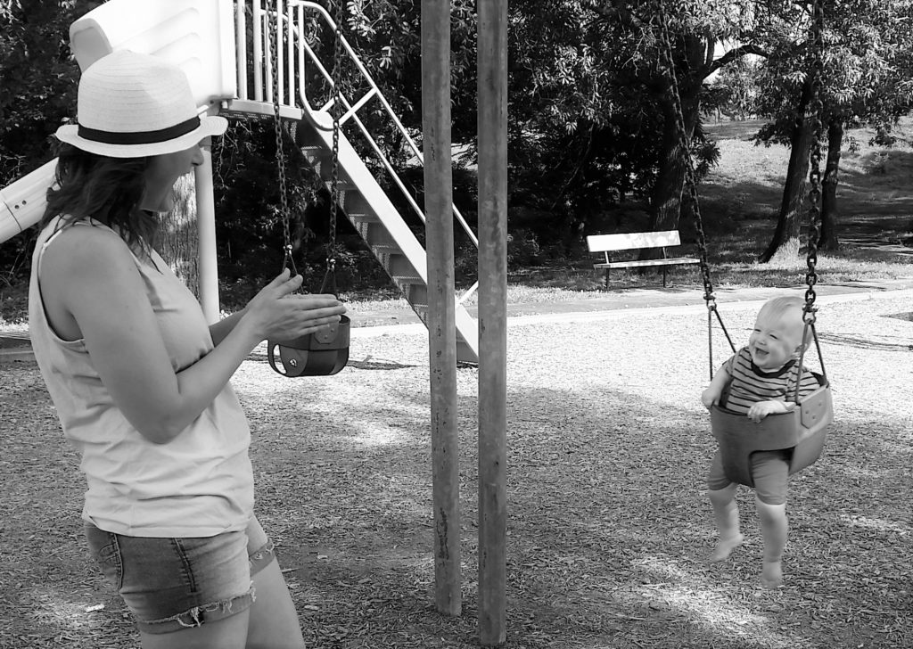 Will and Melissa at park swinging first birthday