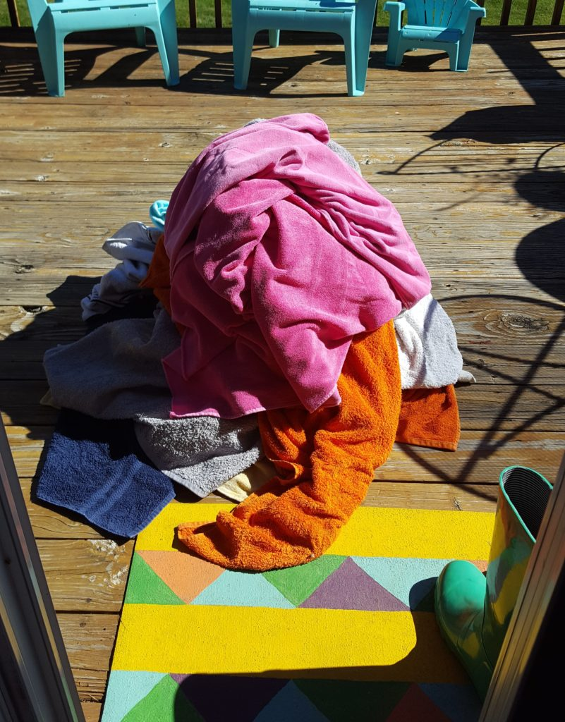 flood-towels-pile-on-deck