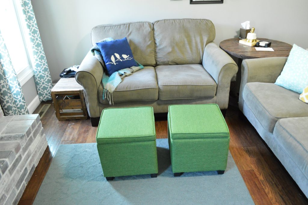 green-storage-ottomans-living-room-3