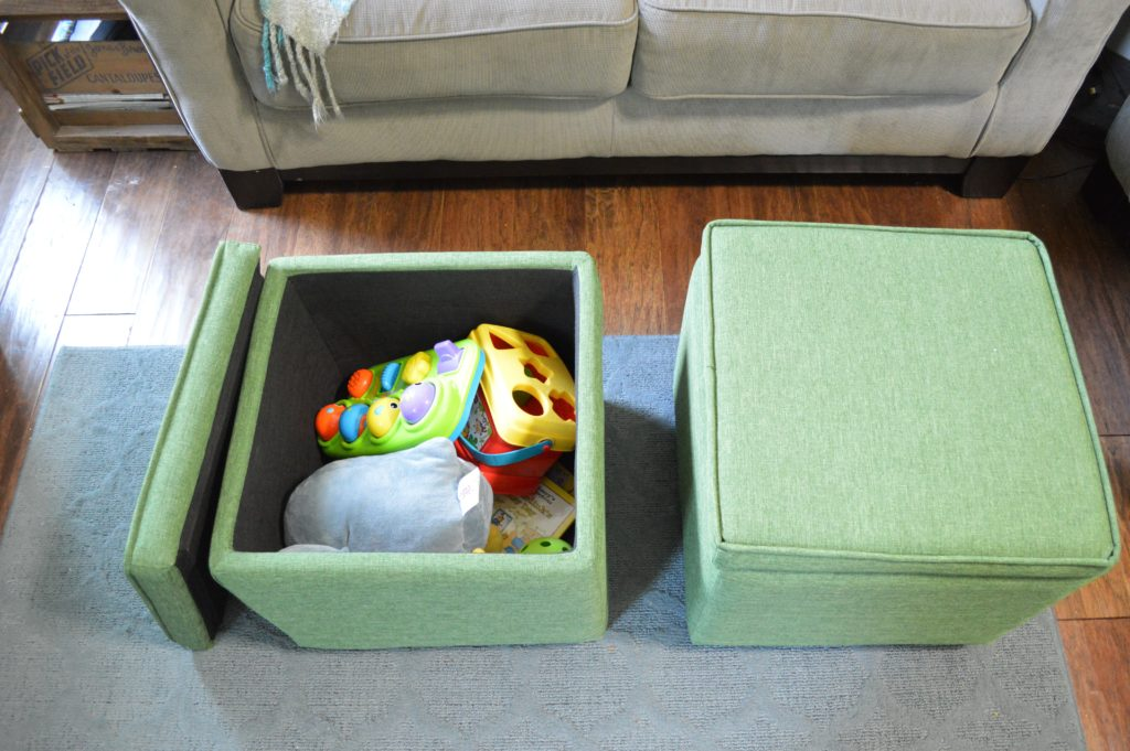 green-storage-ottomans-with-toys-living-room