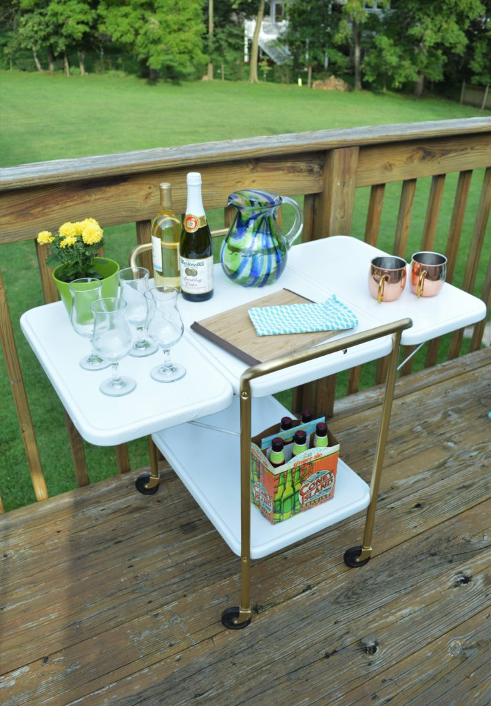 metal-rolling-cart-makeover-after-painted-white-and-gold-outside-bar-cart-2