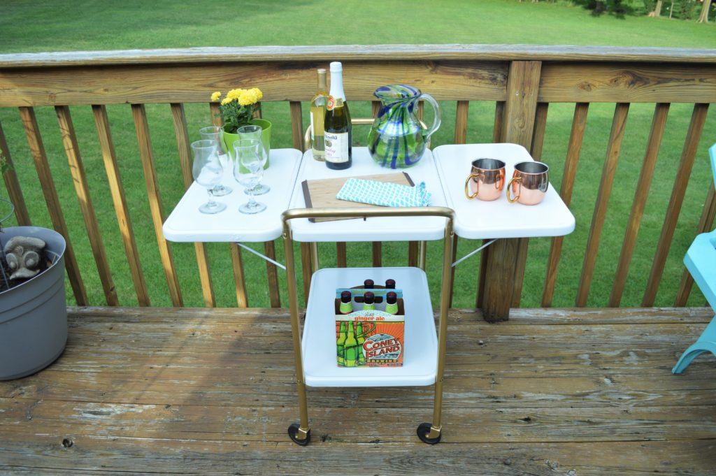 metal-rolling-cart-makeover-after-painted-white-and-gold-outside-bar-cart-3