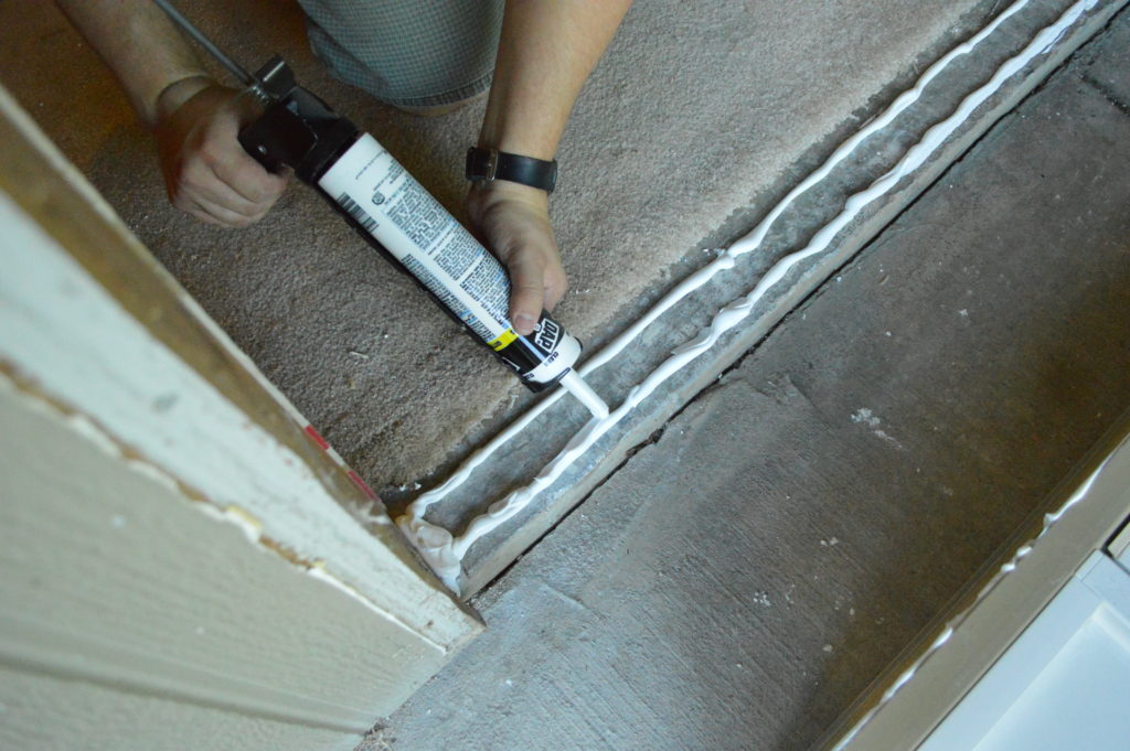 new-basement-door-caulking-concrete-base