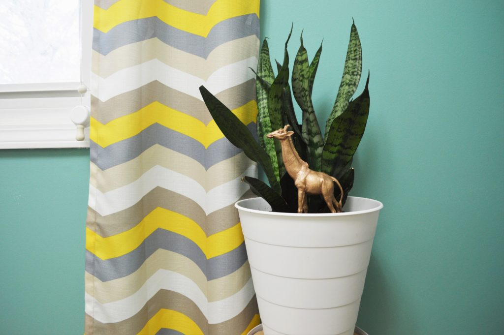 replanted-snake-plant-ikea-hack-trash-can-flower-pot-with-girafe-plant-pick-2