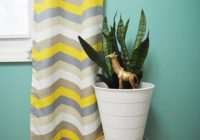 Replanted snake plant Ikea hack trash can flower pot with girafe plant pick 2