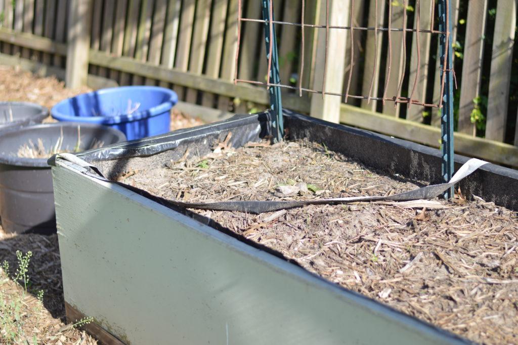 Damaged Raised Garden Beds April 17 tape